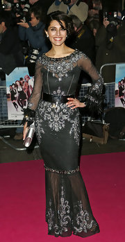 Caterina looked glamorous in a sheer black gown with silver embellishments and feathered cuffs.