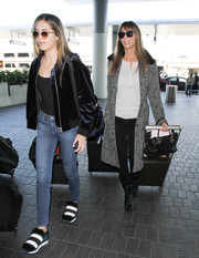 Sistine Stallone was spotted at LAX looking trendy in a blue velvet bomber jacket.