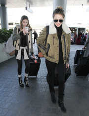 Scarlet Stallone bundled up in a fleece jacket with contrast sleeves for a flight out of LAX.