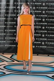 Alice Eve opted for a bold and bright color when she chose this orange-yellow frock for the 'Star Trek Into Darkness' press conference in Mexico City.