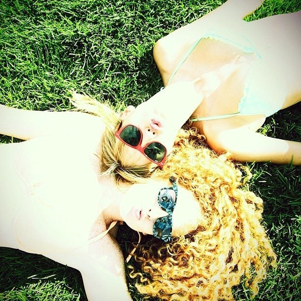 Taylor Swift Does Some Grass Lounging in a Bikini