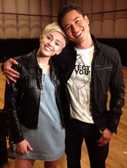 Miley Cyrus styled her dress with a fringed black leather jacket.
