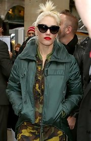 Gwen gave her camo ensemble a feminine edge with sophisticated cat-eye sunglasses.