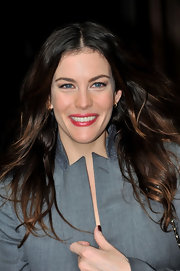 Liv Tyler's teeth looked whiter than ever compared to her pearly pink lipstick.