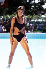 Elisabetta Canalis wore a black cut out one-piece swimsuit for a modeling shoot.