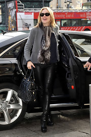 Sharon Stone paired her leather pants with black knee high platform boots.