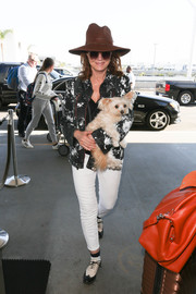 Susan Sarandon was Western-chic in a monochrome leather jacket and a cowboy hat while catching a flight out of LAX.
