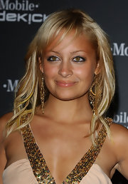 This is an example of hair-extensions gone wrong. Nicole Richie has put her hair through so much, her golden locks are starting to look brittle and thin. What a shame.