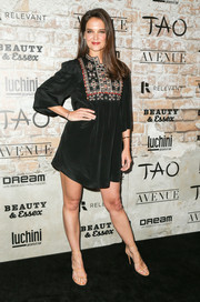 Katie Holmes kept it laid-back in a black tunic dress by Isabel Marant that the actress paired with Tamara Mellon shoes at the TAO, Beauty & Essex, Avenue and Luchini LA grand opening.