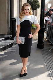 Catherine Tyldesley looked classic and sophisticated in this '40s-inspired black and white frock with puffed sleeves.