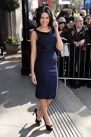 Michelle Keegan opted for a navy cocktail dress with satin neckline for her red carpet look at the TRIC Awards.