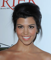 In true Kardashian style, Kourtney completed her look with long lashes that perfectly offset her peachy cheeks.