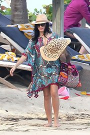 Jenna looked perfectly colorful on the beach in this tasseled paisley cover-up.