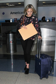 Taylor Schilling pulled along a navy nylon suitcase while making her way through LAX.
