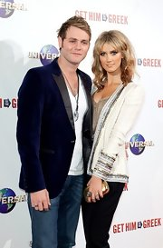Delta Goodrem glittered in a white jacket with gold and silver sequins layered over a metallic camisole.