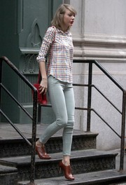 Taylor Swift donned a boyish grid-print button-down for a day out in New York City.