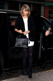 Taylor Swift kept it simple in a black blazer layered over a little white dress while out and about in New York City.