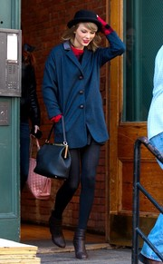 Taylor Swift teamed brown Rag & Bone ankle boots with an oversize blue blazer for a day out in New York City.