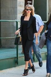 Taylor Swift donned a cute black Reformation jumpsuit with a blazer for a day out in New York City.