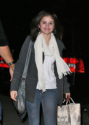 Selena Gomez dons a thin white pashmina with her casual shopping wardrobe while out with Taylor Swift.