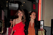 ***NO GERMANY / SWITZERLAND***.Taylor Swift dons another bright red dress when she is seen leaving Benihana restaurant.