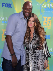 Lamar Odom opted for a casual look during the 2011 Teen Choice Awards with this pastel-blue button-down and jeans combo.