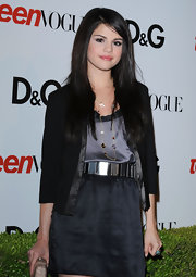 Selena adds a touch of shine to her look with a mirrored leather belt at the Teen Vogue party.