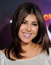 Daniella Monet look naturally beautiful with less color on -- lightly lined eyes and nude lips.