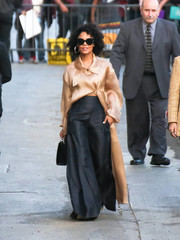 Tessa Thompson headed to 'Kimmel' wearing a dramatic nude satin coat.