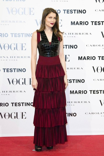 Laetitia brought the drama in this Merlot tiered leather-clad gown with matching lips.