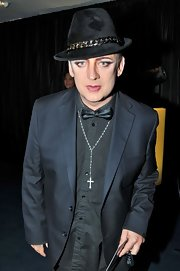A cross pendant blinged out Boy George's neck this evening.