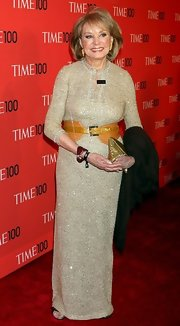 Barbara Walters sparkled on the red carpet for the Time 100 Gala where she wore a three-quarter-length sleeve dress and a wide leather belt.