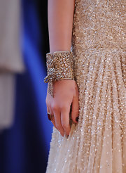 Teen queen Miley Cyrus wore a sequined embellished dress down the Oscar red carpet, she hit the style mark dead on by pairing it with this gold and diamond bracelet.