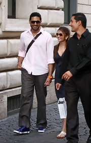 Abhishek Bachchan was in the mood for some color, pairing blue sneakers with a pink top while touring Rome.