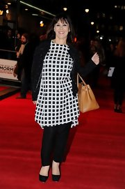 Arlene Phillips wasn't afraid to mix some prints when she paired this animal print zip-up with a checkered tunic.