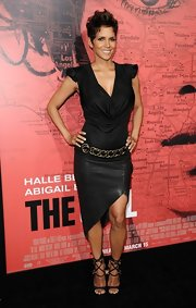 Halle Berry looked slightly edgy at 'The Call' premiere where she sported an asymmetrical leather skirt.