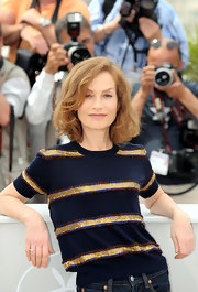 Gold stripes took Isabelle Huppert's knit top from simple to fab.