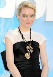 Emma Tone added some metallic pendants to her red carpet look for a sleek and modern look.