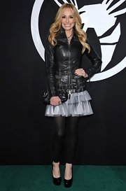 Taylor wore a tiered tulle mini skirt with a black leather jacket.