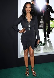Garcelle paired her body-skimming dress with strappy black sandals adorned with metal studs.