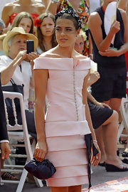 Charlotte Casiraghi wowed at the Grimaldi wedding in a tiered pink off-the-shoulder satin dress with a black bow detail.