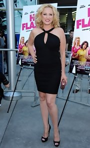 Virgina opted for a sleek, fitted LBD that featured a criss-cross halter neck and a cutout detail.