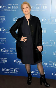 Meryl Streep keep things simple at a photocall for 'The Iron Lady' in a black collarless coat and a navy sheath.