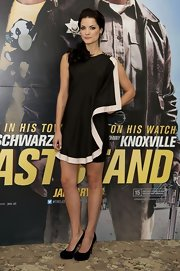Jaimie Alexander went for a black-and-white look at the 'Last Stand' photocall in this draped cocktail dress.