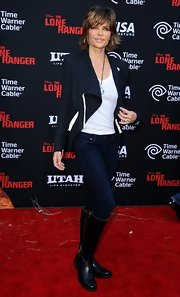 Lisa Rinna teamed flat knee-high boots with skinny jeans and a chic jacket for her 'Lone Ranger' red carpet look.