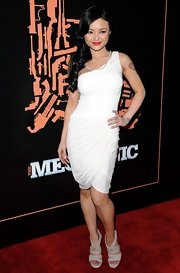 Tila is white hot in a one-shoudler cocktail dress at 'The Mechanic' premiere.