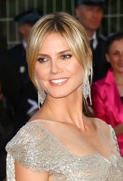 Heidi Klum arrived for the Cannes premiere of 'The Paperboy' wearing her hair in a casual bun with her long bangs swept off to the sides.