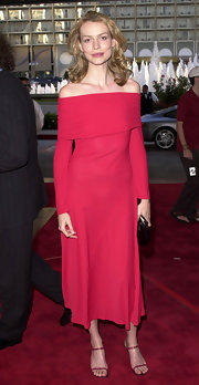 Saffron Burrows' red strappy sandals were a sexy complement to her dress.