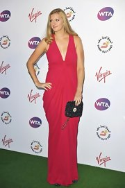 A studded handbag changed the mood of Petra's cheerful pre-Wimbledon party look.