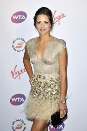Ana Ivanovic showed her glamorous side with this beaded and feathered gold cocktail dress at the pre-Wimbledon party.